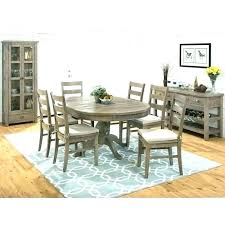 rug under kitchen table how to place a rug with round dining table area rug under