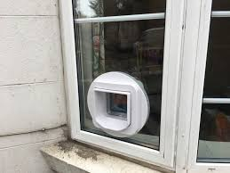 microchip cat flap fitted in double glazed window