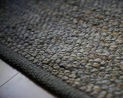 gray jute rug dark close up 9x12