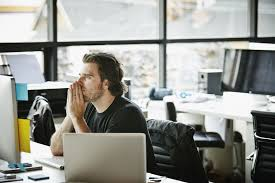 two weeks notice resignation email message man thinking in office