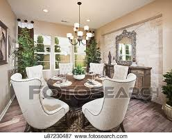 wingback chairs at dining table in house irvine california usa