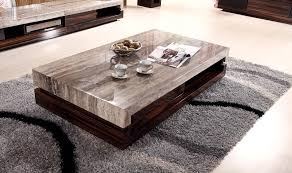 vintage look modern low profile coffee table with marble top with cappuccino color and dark brown wooden base on gray carpet tiles in living room