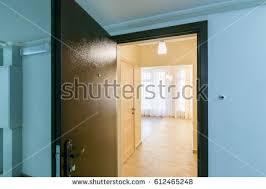 open front door. The Open Front Door In Renovated Apartment New Building H