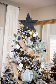 Creative christmas tree toppers ideas try Decor Country Living Magazine 35 Unique Christmas Tree Toppers Cool Ideas For Tree Toppers