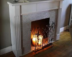 an elegant electric fireplace with a white mantle