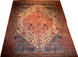 name mobarak badbijar dimension 9ft 3in by 14ft 11in from northwest of persia age 1900 color aqua blue beige and pink