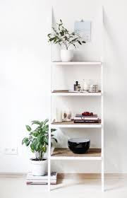 white ladder shelf with wood shelves