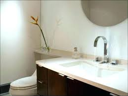 how to install corian solid surface shower walls wall material tub size of for design best
