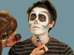 painting bone detail on neck for skeleton makeup