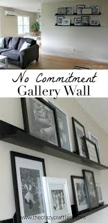 creating a no commitment gallery wall use picture ledges and layer frames you can
