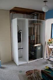 cabinet to hide the boiler and fuse box ikea hackers hidden fuse box one of the 50cm cabinets was used to hide some pipes and a fusebox the cabinet was assembled according to the instructions with only half of the back and
