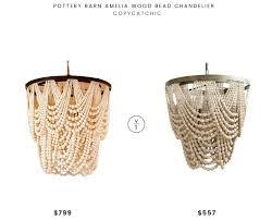 pottery barn amelia wood bead chandelier 799 vs metal and wood bead chandelier 557 rustic wood