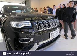 Jeep Design Checks A Worker Checks A 2013 Jeep Grand Cherokee Of Chrysler In