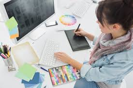 graphic design office. artist drawing something on graphic tablet at office design