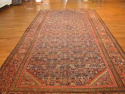 rust and blue heriz antique persian rug