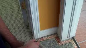 carpet tack strip installation around a door jamb