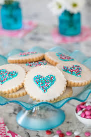 photo of a turquoise display pedestal of easy decorated shortbread cookies on a granite countertop with