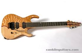Custom Shop 3-piece Melted Top Sidewinder 7 string guitar & Custom 7 String Guitar Curly Maple Purpleheart Quilted Maple 1 Adamdwight.com