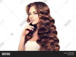 Hairstyles Female Hair Loss Model With Long Hair Waves Curls Hairstyle Hair Salon Updo