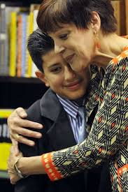 stamford student s essay wins award for teacher stamfordadvocate miriam gonzerelli hugs her student luis guaillas after he his winning essay