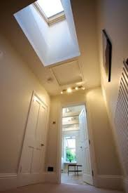 lighting for hallways and landings. a new simple kitchen design with velux windows improves the feeling of light and lighting for hallways landings