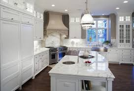 Exellent Modern White Kitchen Wood Floor Large Island With Marble Countertop Is Centerpiece To Beautiful Design