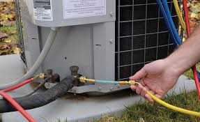 gas ac unit. Contemporary Unit A Technician Adds A Refrigerant Sealant To The Suction Side Of  Residential Air Conditioning Unit With Gas Ac Unit