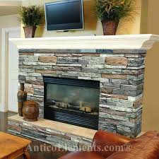 wood mantel on stone fireplace stacked stone fireplace but with a dark cherry wood mantle how