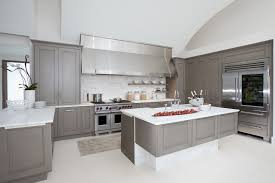u shaped grey stained island kitchen cabinets white marble countertops double handle facuet chrome undermounted sink bottle built in refrigerator cooking