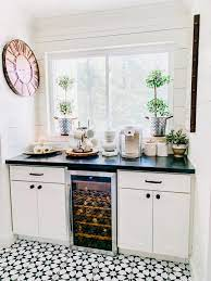 Love the decor and styling of this contemporary coffee station! 15 Home Coffee Station Ideas For Every Budget