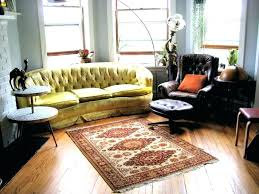 area rug with brown couch under living room oak flooring ideas clearance rugs to match area rug
