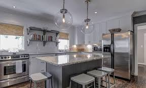 parisian architectural lighting. transitional kitchen with island, avalon white granite countertop, parisian architectural clear glass poste lighting m