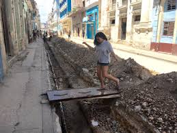 first time in a personal essay from a second generation in centro habana i walk across a door used to connect to the sidewalk during construction