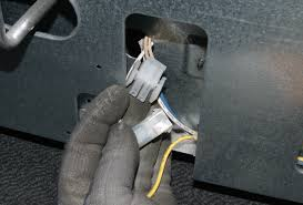 how to replace a gas oven igniter repair guide help sears release the locking tabs and unplug the wire harness
