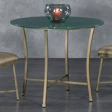 sumter small round glass table by wesley allen shown in a golden bisque finish