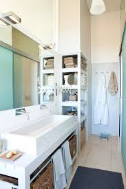 view in gallery shelving replaces a section of the wall beside this bathroom s vanity