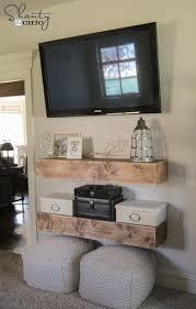 open floating media shelves under the tv shanty2chic