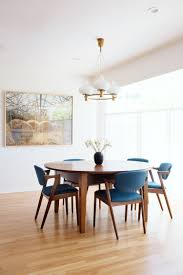 minimalist mid century modern inspired dining room decor with blue chairs simple minimalist design california living by carter design rue