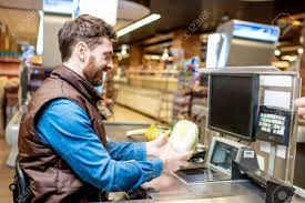 Happy Cashier Working At The Cash Register In The Supermarket