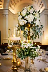 Elegant and Traditional Wedding Reception Dcor with Gold and Ivory  Centerpieces in Tall Vases with Cascading