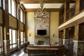 rustic living room with chandelier restoration hardware adirondack antler three tier chandelier hardwood