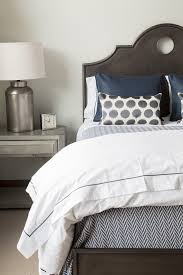 beautiful peacock bedding in spaces rustic with next to custom nightstand alongside and peacock alley coverlet