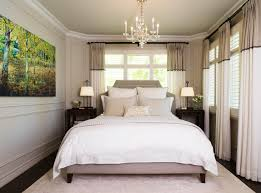 best paint colors to make a small bedroom look bigger with bedside table and crystal chandelier