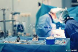 Operation Room Technician Surgical Nurse Pick Up Sterile Instrument In The Surgery Operation