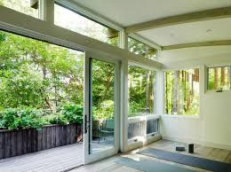 view in gallery sliding glass doors providing views of sunrise and the trees