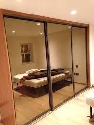 installing closet doors installing a sliding door tinted mirror doors with cherry interior installing sliding closet installing closet doors