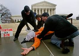 why republicans are debating bringing back torture vox amnesty international protests u s detentions at guantanamo