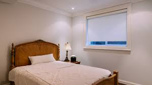 basement level interior of small bedroom in newly built north american private home