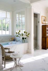 bright bathtub caddy in bathroom traditional with light over tub next to tiles around tub alongside handicap shower and frameless shower door