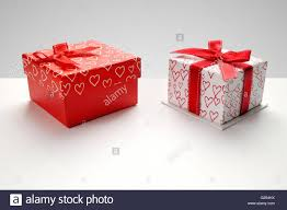 Decorative Holiday Boxes Two decorative gift boxes with red ribbon and hearts printed on 45